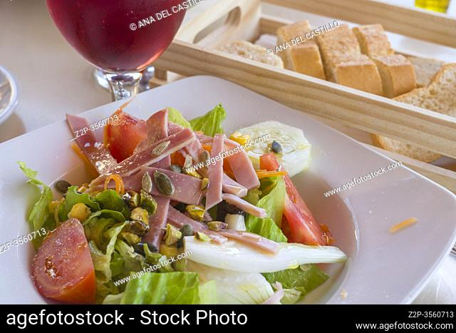 Vegetable tasty salad with ham and nuts Spain