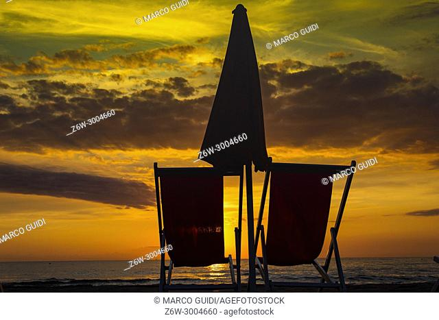 Chair on the beach seen at the sunset of the winter sea