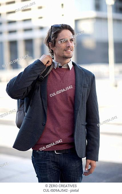 Mid adult man walking in city