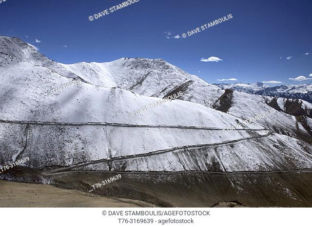 Switchbacks up the snowy Chang La Pass, above the Stok Range and Indus Valley, Ladakh, India