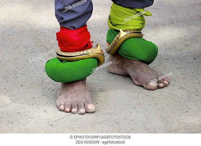 Brass bangles on feet. Pandharpur festival