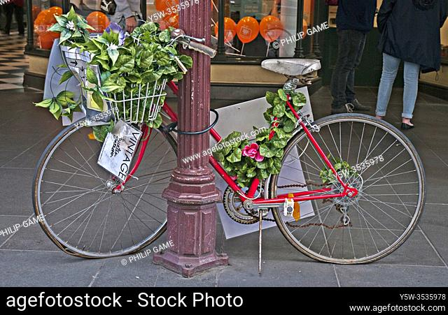 Bicycle parked in the Bourke Street Mall serves as a moveable prop for retail store displays, Melbourne, Australia