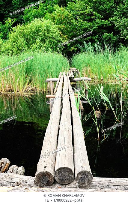 Ukraine, Dnepropetrovsk region, Novomoskovsk district, Wooden footbridge over waterbay
