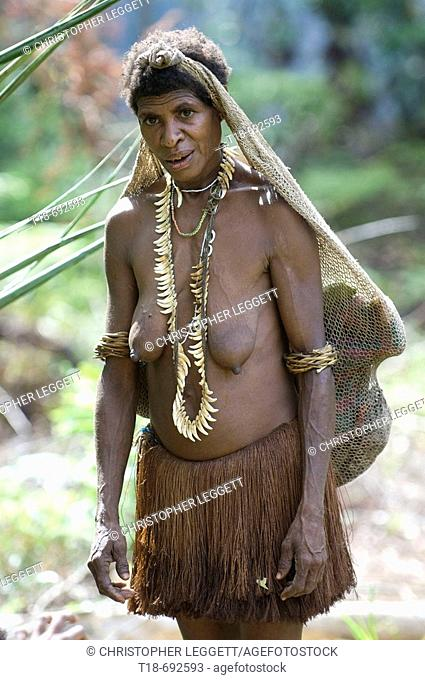 Papuan tribeswoman carrying net bag, Indonesia