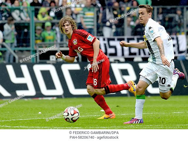 Gladbach's Max Kruse (R) and Leverkusen's Tin Jedvaj vie for the ball during the German Bundesliga soccer match between Borussia Moenchengladbach and Bayer...