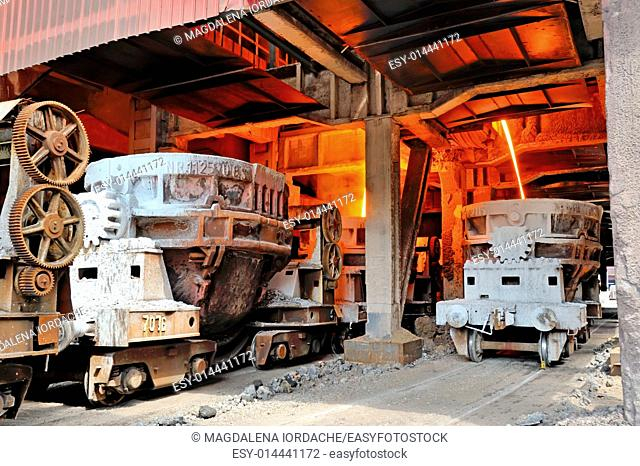 steel buckets to transport the molten metal inside of plant