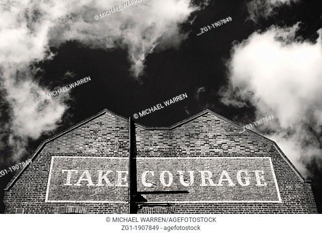 Building in Southwark London with Take Courage painted on it