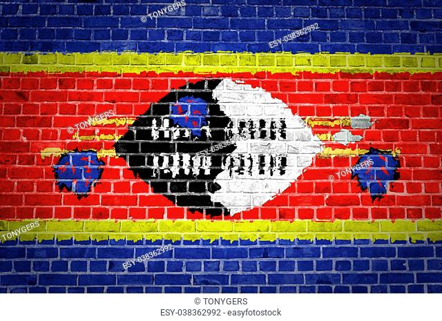An image of the Swaziland flag painted on a brick wall in an urban location