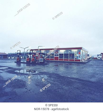 A petrol station in a town in wet weather