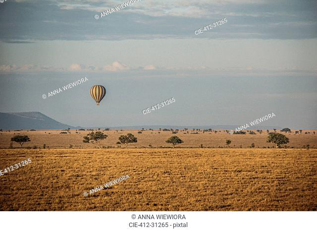 Hot hair balloon floating over tranquil desert, Serengeti, Tanzania