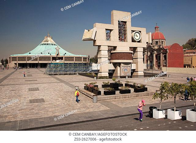 Tourists in front of the New Basilica Christmas Creche Shrine of the Guadalupe and The Carillon, Cross-shaped image symbolizing the cosmos and called...