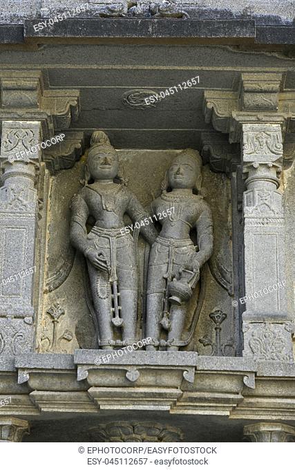 Statue on stone wall carvings at Vitthal Temple, Palashi, Parner, Ahmednagar