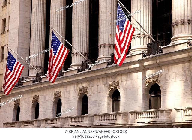American flags fly outside of the New York Stock Exchange in Lower Manhattan, New York City USA