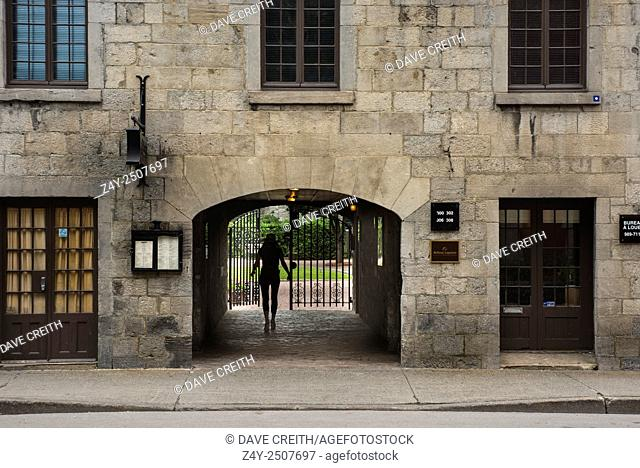 Silhouette of a woman in a passage way, Old Town, Montreal, Quebec, Canada