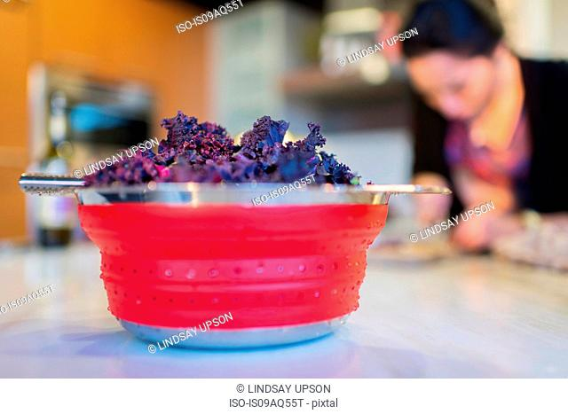 Bowl of fresh purple kale on kitchen counter