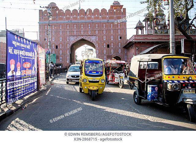 Johri Bazaar; Rickshaws driving along road in Jaipur, India