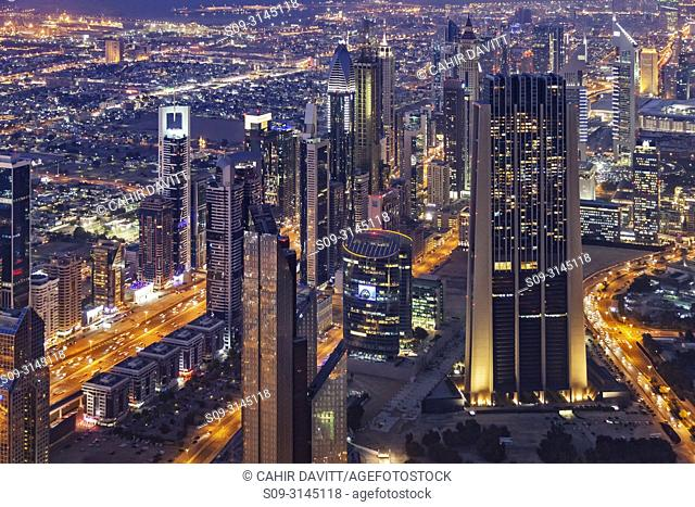 Aerial view of the Sheik Zayed Road at night with The Index building in the foreground designed by the architects Foster and Partners, Downtown Dubai, Dubai