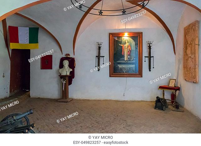 The museum's room in the castle of St. Micloses in Chinatyevo is modestly furnished with historical finds and with the flag of the principality and the portrait...