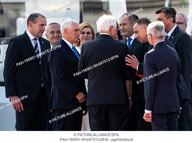 01 September 2019, Poland, Warschau: President Frank-Walter Steinmeier (M) is talking to Mike Pence (3rd from left), Vice President of the USA