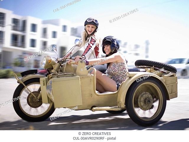 Women riding a motorbike