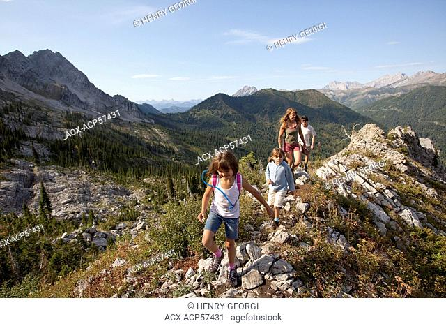 Young family hikes on Spineback Trail in Lizard Range, Fernie, BC, Canada