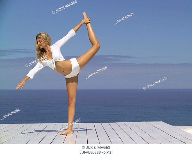 Woman dancing on boardwalk