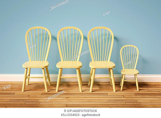 Three large chairs and one small chair in an empty room