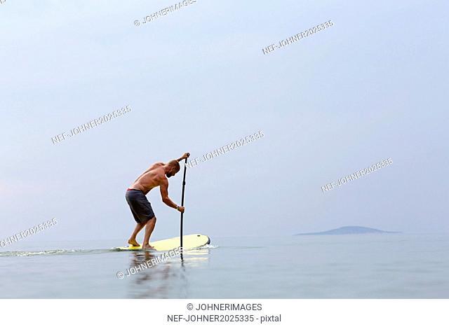 Man on paddle board