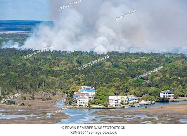 Fire blazes in forest close to coastal waters, South Carolina