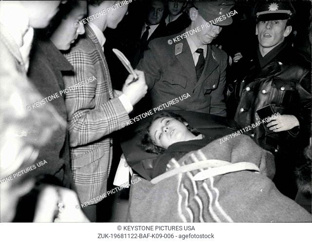 Nov. 22, 1968 - Pictured here is 18 year old Renate Vogel as she is being transported to a hospital. She was one of many protestors who were injured by order...