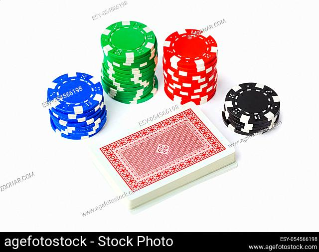 Gambling casino chips and playing cards isolated on white background