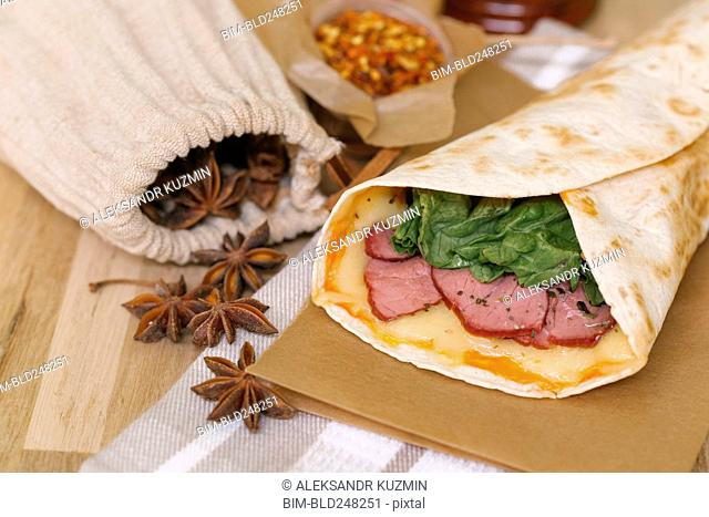 Meat and melted cheese in wrap