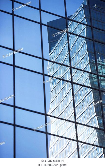 Building reflecting in exterior glass panels