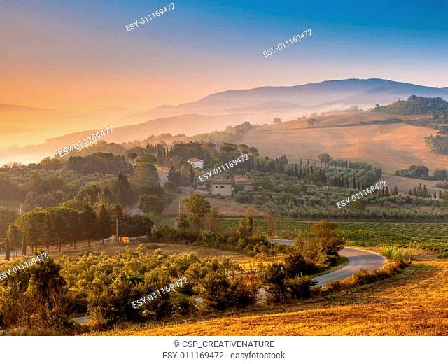 Tuscan Village during Foggy Sunrise