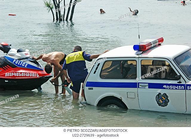 Lake Sevan, Armenia: a police car rescuing a police jet-ski at the beach