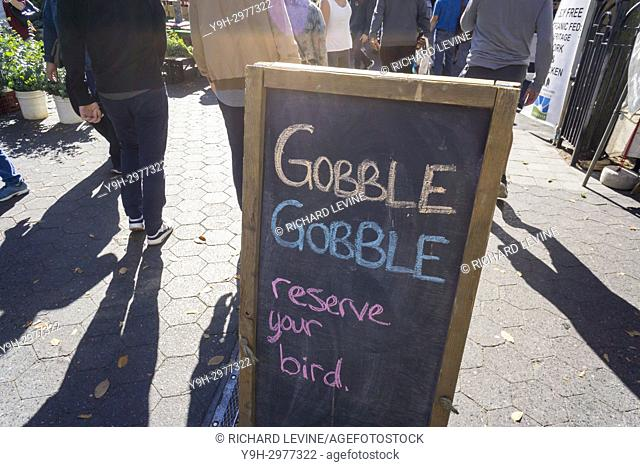A sign reminds shoppers prior to Thanksgiving that local turkeys are available for pre-order in the Union Square Greenmarket in New York on Saturday, October 28