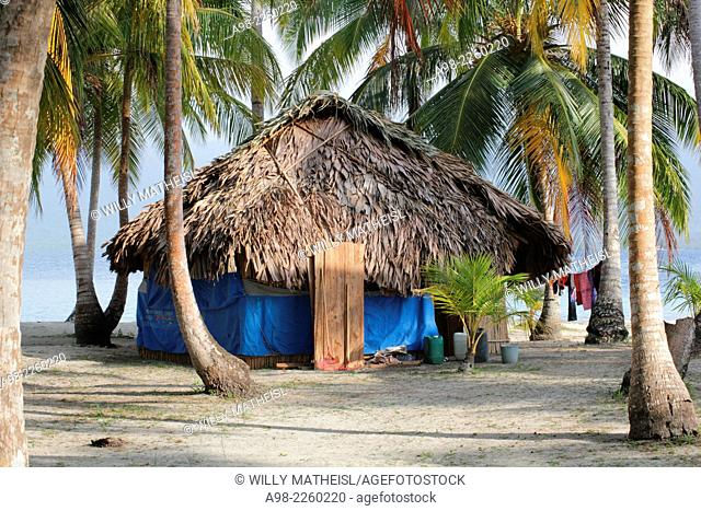 traditional hut of the Kuna Indians on the sandy beach of San Blas Islands, Panama, Central America