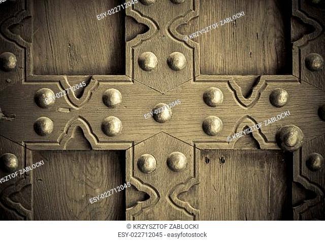 Old wooden background with metal rivets vintage door detail