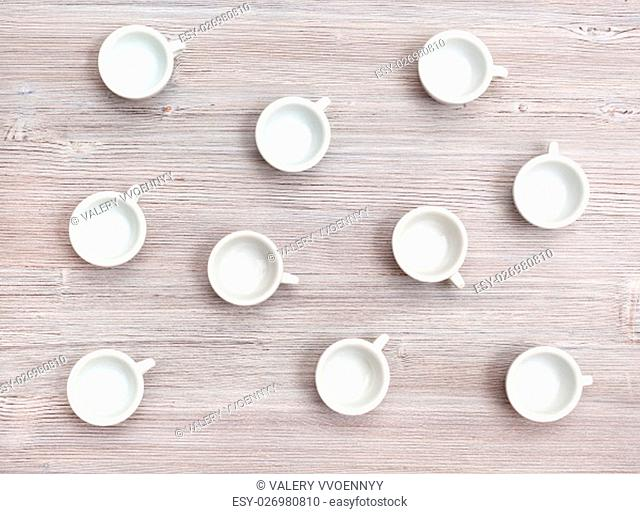 food concept - top view of many white cups on gray brown table