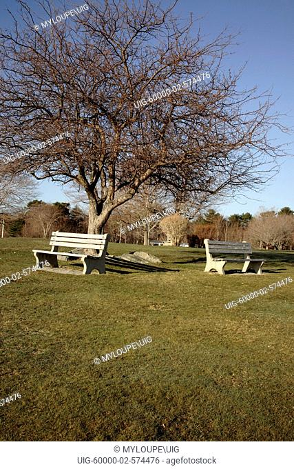 Bench in park.....New Castle, New Hampshire, USA during the spring months. Located in scenic New England