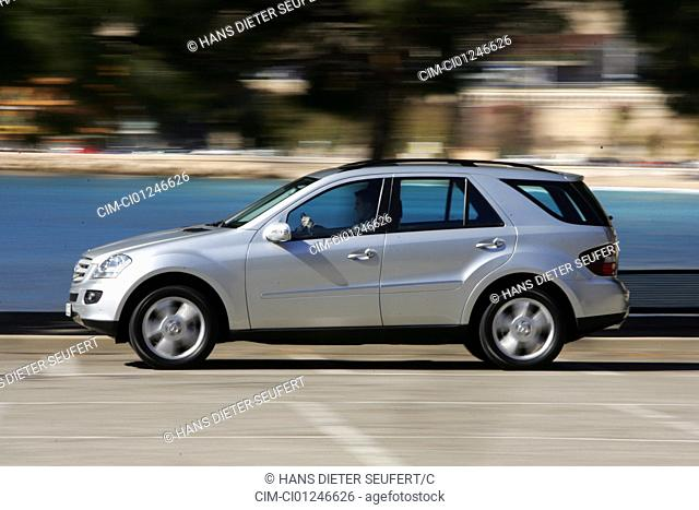 Car, Mercedes ML 500, model year 2005-, silver, cross country vehicle, driving, side view