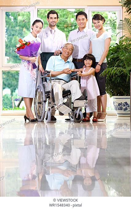 Doctor and nurse with patient family