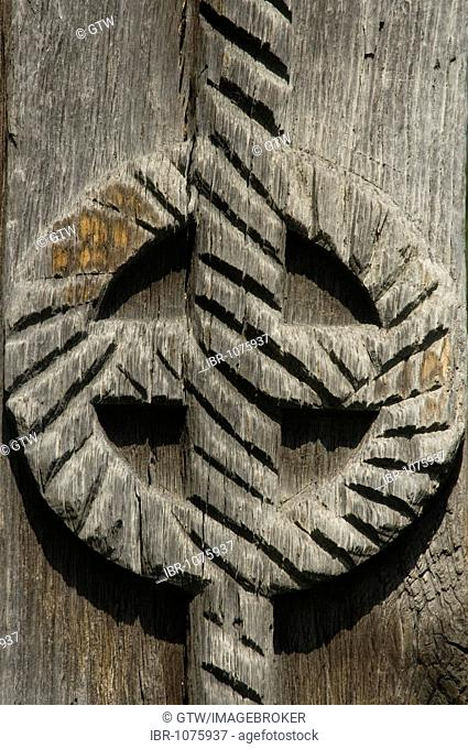 Carved wooden portal, disc symbolizing the sun, Maramures, Romania
