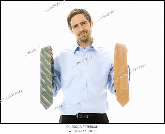 man choosing a tie