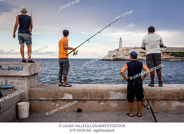 Fishermen, in Malecón,on the background the Castillo de los Tres Reyes del Morro, La Habana, Cuba