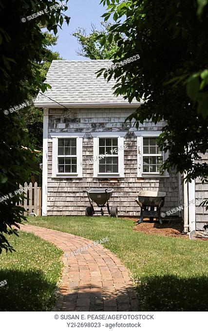 Wheelbarrows by a shingled home in Vineyard Haven, Martha's Vineyard, Massachusetts, United States, North America. Editorial use only