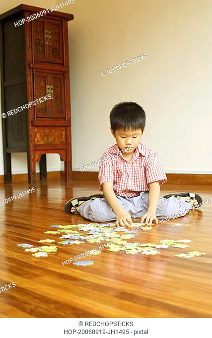 Boy playing with a jigsaw puzzle