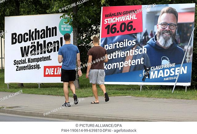 13 June 2019, Mecklenburg-Western Pomerania, Rostock: Passers-by will pass election posters for Steffen Bockhahn (l-r), candidate of the left