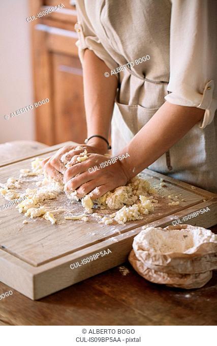 Woman preparing dough for gnocchi