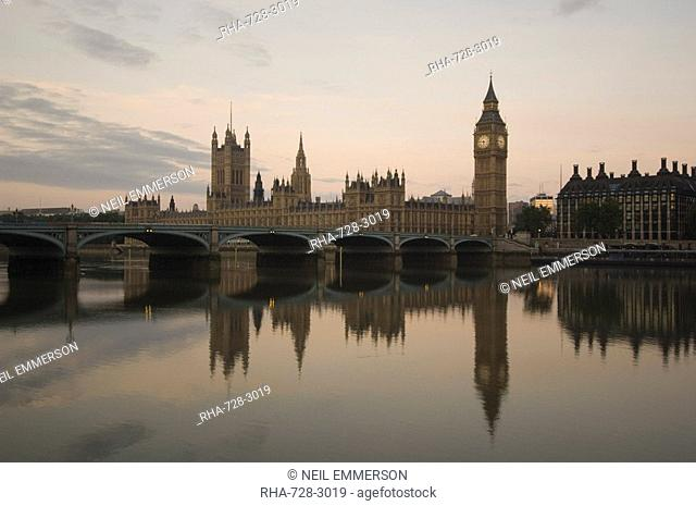 Westminster Bridge, Big Ben and the Houses of Parliament reflected in the calm water of the River Thames, London, England, United Kingdom, Europe